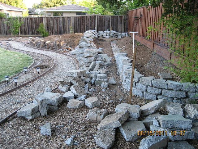 reusing broken concrete for retaining wall
