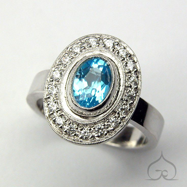 Verlovingsring in witgoud met blauwe topaas en briljanten.  trouwring, trouwringen, trouwen, verlovingsring, titanium, goud, zilver, diamant, briljant, goudsmid, edelsmid, juweelontwerp, juweelontwerper, ontwerpen, topaas, edelsteen, briljant, diamant, diamantjes, diamanten, bruid, bruiloft, trouwfeest