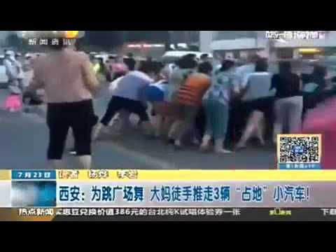 Dancers move car out of their makeshift dance floor in China