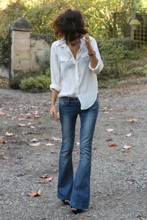 Simple white sheer blouse and flare leg jeans... definitely me.