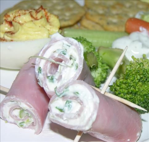 Ham and Cream Cheese Rollups from Food.com:   A few years a go, an employee of mine brought these to our office Christmas party. I got a couple, (never had them before), when no one was looking I went back for a few more. After that I couldn't stand it I made a complete pig of myself. They are great! I've make them so much for parties what use to take 2 hours prep time takes 30 minutes.