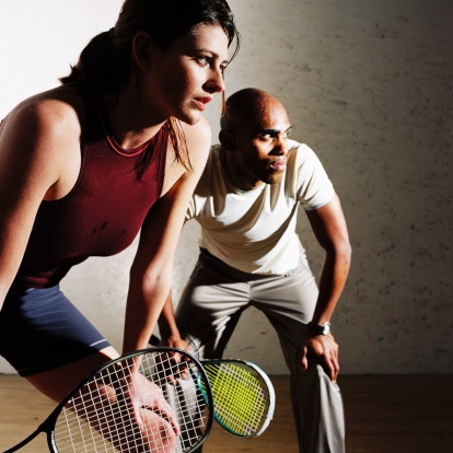 Squash is the most complete sport to ever exist, couple on a squash court.