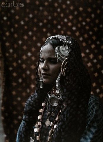 India | An informal portrait of a Hindu woman covered in traditional jewelry | © Gervais Courtellemont, National Geographic