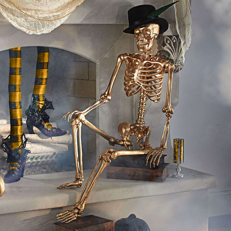 get a dollar store skeleton and spray paint him gold and toss a top hat on him for a classy halloween prop - Classy Halloween Decorations