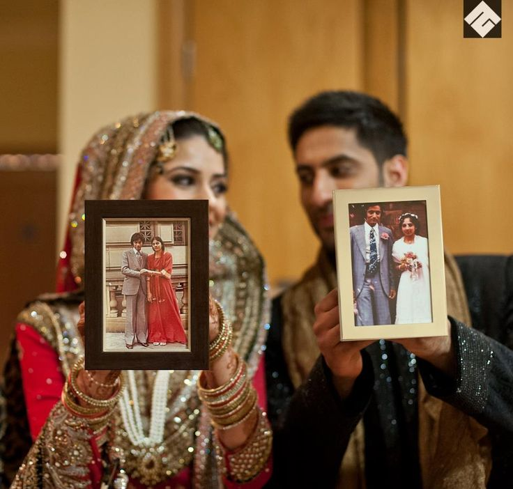 A slice of family history, never to be forgotten - the bride and groom holding up photos of their parents getting married.