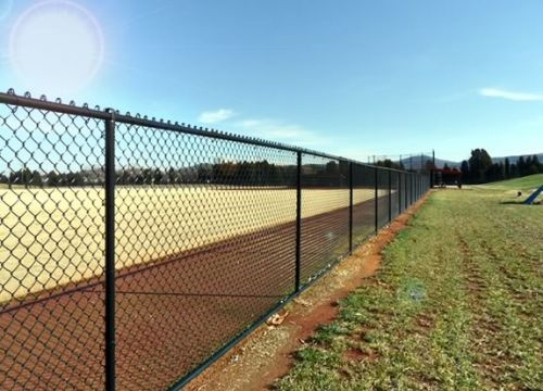 Black Vinyl Coated Chain Link Fence At Baseball Field