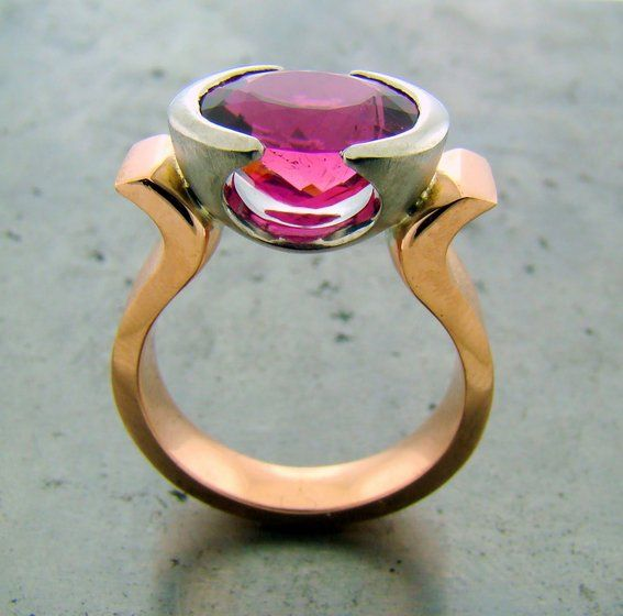 Custom Made Pink Tourmaline Ring - Pink oval tourmaline set in partial palladium bezel. Stone is weighed at 2.02ct. The rose gold shank has curvaceous lines that open up at the top for the bezel. The inside and sides of the shank are a high polished finish, with the outside of the band has a matte, textured finish.