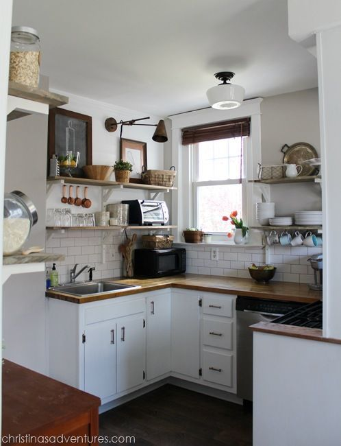 DIY Farmhouse Kitchen done on a really small budget! #kitchen #openshelving #subwaytile #plankedwall