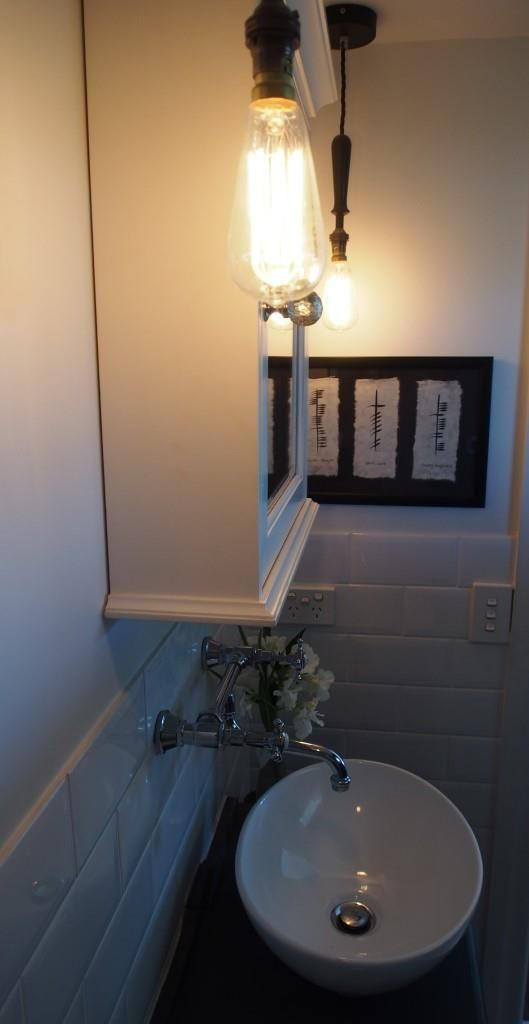 Pendant lights, mirror cabinet, above mounted vanity basin, traditional wall mounted tapware.