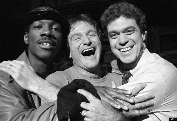 """Williams guest-hosted """"Saturday Night Live"""" in 1984. He's shown here with SNL stars Eddie Murphy and Joe Piscopo, via AP."""