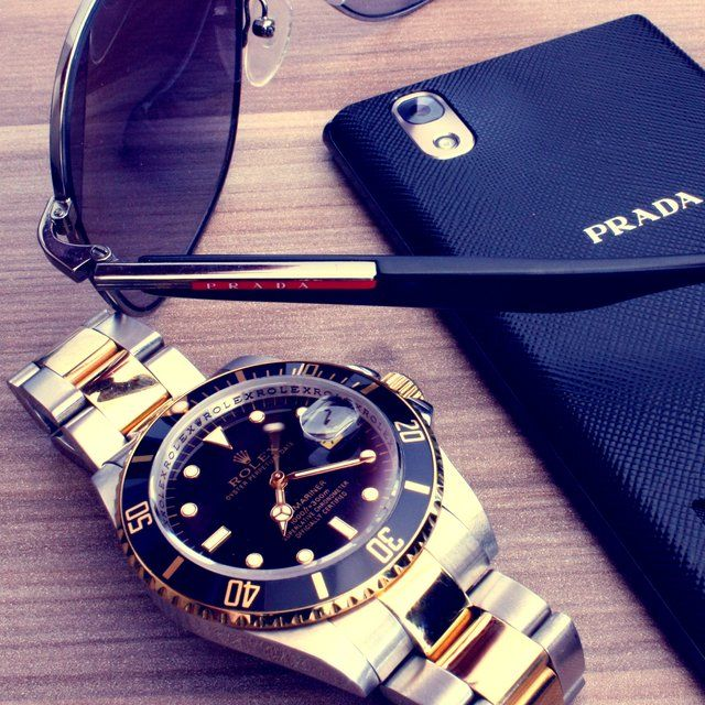 Gold and Steel Rolex Submariner. Prada case. Sophisticated goods. Luxury brands. Luxury lifestyle. Take a look at: www.bocadolobo.com