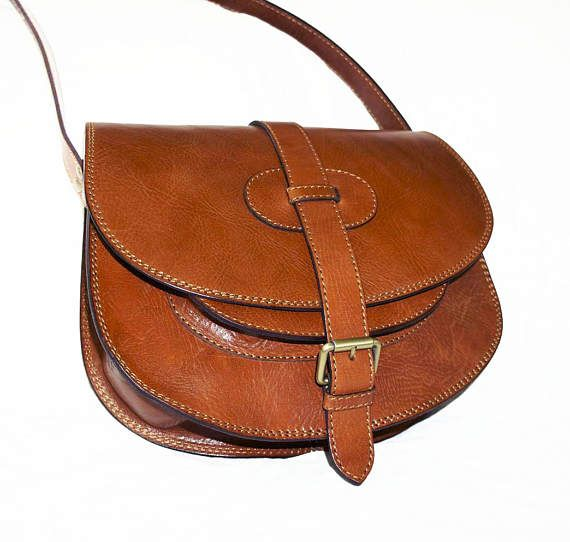 Leather Saddle Bag, Leather Messenger Bag, Leather bag, Leather Messenger, Leather Messenger Bag, Leather Purse, Leather Cross-body Bag, Goldmann S in vintage distressed brown The bag is made from vegetable tanned genuine cow leather with aged finish. Small marks make the bag looks antic and unique.  PLEASE LEAVE A CONTACT PHONE NUMBER FOR DELIVERY VIA DHL. Estimated DHL Express delivery time: 3-4 business days to the USA, Canada, EU and 4-8 days to Australia, New Zealand, Japan and other…