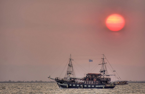 Sunset at Thermaikos Gulf over a boat @Thessaloniki , GREECE