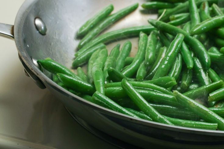 Yay! I bought a huge bag of frozen organic green beans from Costco because we were wasting fresh, but they seemed so rubbery. This recipe works great! I had a snack of sauteed green beans with herbs today and the texture was perfect. Try it, takes less than 7 minutes!