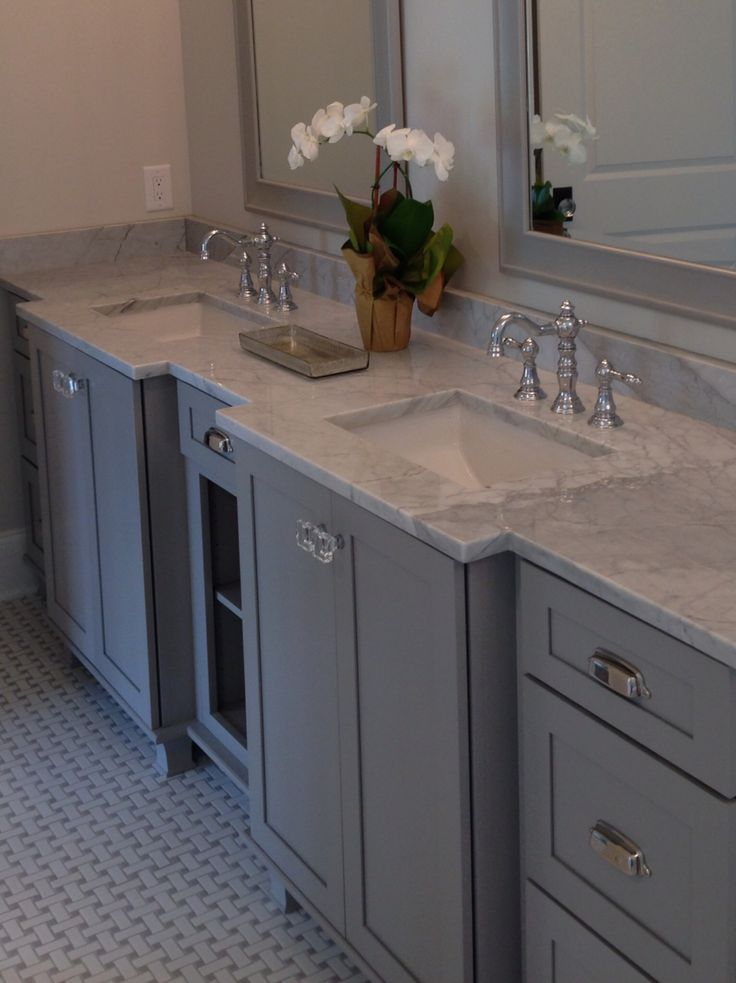 Kraftmaid pebble gray carrara marble master bath and for Grey bathroom cupboard