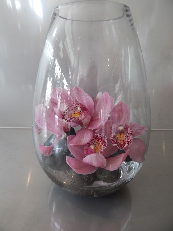 For reception table at beauty therapist, cymbid orchids in teardrop vase.