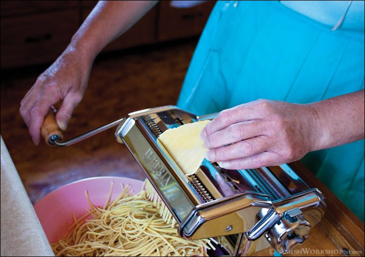 Amish woman using a pasta maker to make Amish noodles.  Includes noodle recipe.  We don't use water to make our noodles...this is an interesting recipe.