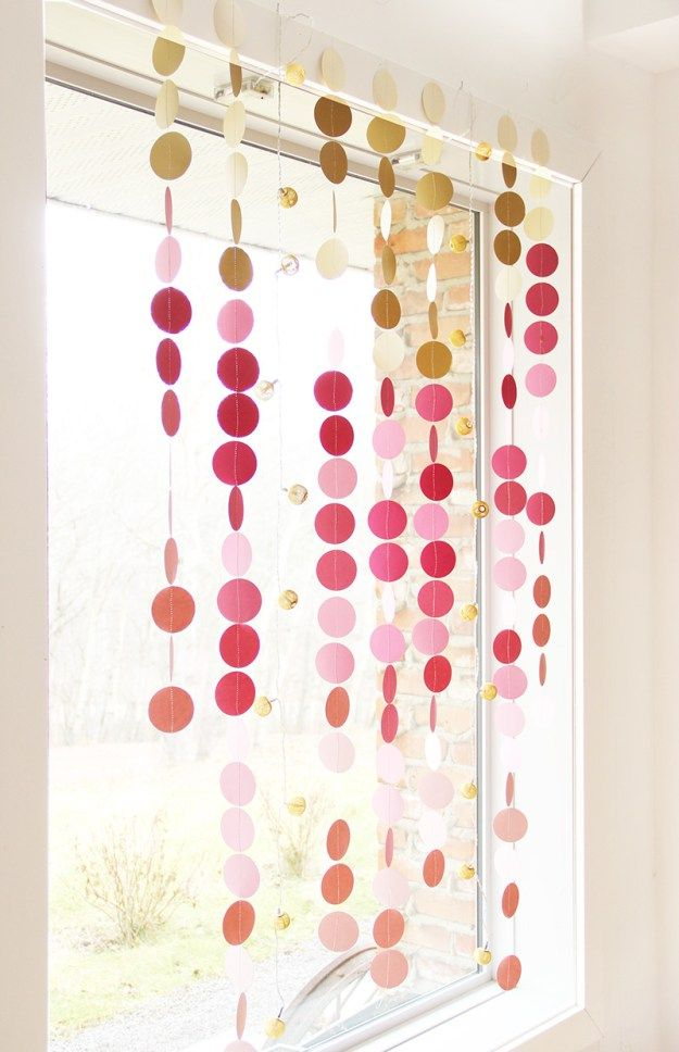 How to make circle paper garland with regular card stock paper and a circle punch. Sew together to create custom party, and holiday home decor. An easy and inexpensive festive touch for any gathering.