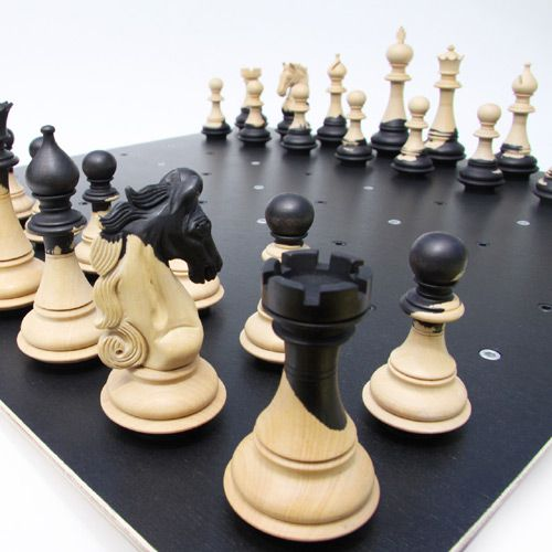 Unique Chess Set. A luxury Chess on Dots set with dots instead of squares for improved playability, more transparency and self-centering Chess Pieces.