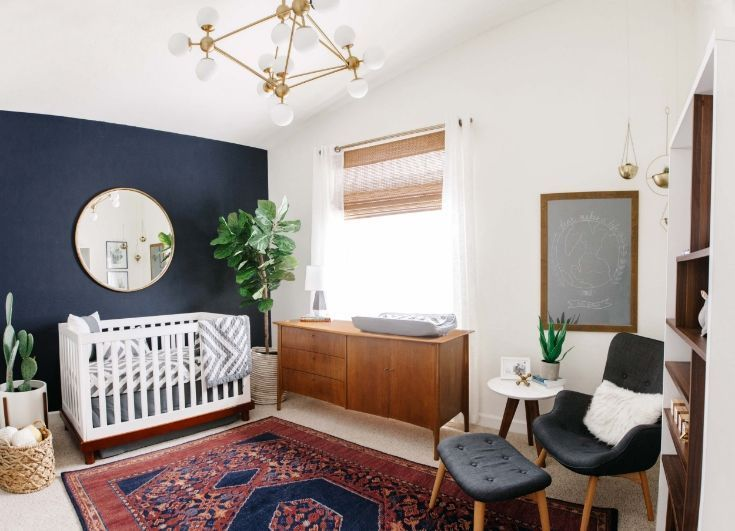 A Masculine And Modern Nursery With Mid Century And Traditional Elements Dark Navy Walls Baby Nurs Baby Room Decor Mid Century Modern Nursery Nursery Room