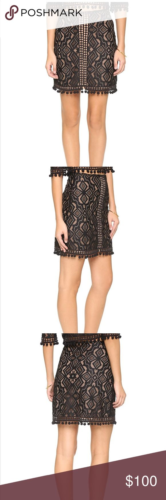 For Love and Lemons Black And Nude Lace Pom Skirt A contoured For Love & Lemons miniskirt in romantic lace. Pom-poms trim the hem. Hidden side zip. Nude lining.  Fabric: Lace. Shell: 60% polyester/40% nylon. Lining: 90% polyester/10% spandex. For Love And Lemons Skirts Mini
