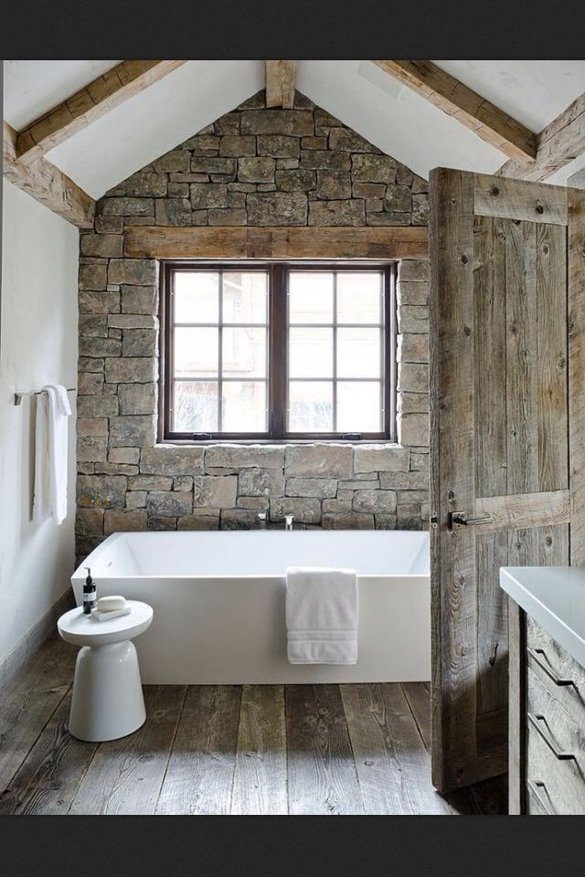 Really like this decorating style. Rustic farmhouse. Maybe a bit TOO much wood, but still a pretty bathroom with freestanding tub #Farmhouse #bathroom