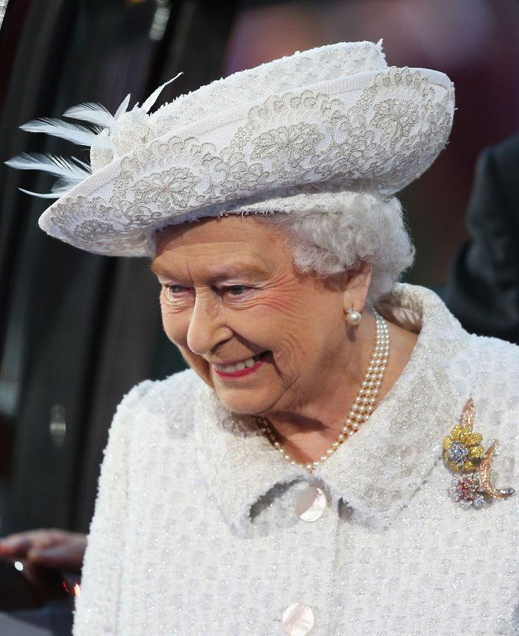 Queen Elizabeth II, Patron of the CGF smiles during the Opening Ceremony for the Glasgow 2014 Commonwealth Games at Celtic Park on July 23, 2014