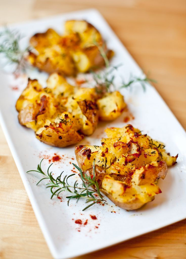 Crash Hot Potatoes. Preheat oven to 450. Boil potatos till tender, arrange on oil-drizzled cookie sheet. Make an X in each potato, smash, sprinkle with salt, pepper and parmesan cheese (if desired) and rosemary. Drizzle with olive oil and bake for 20-25 minutes