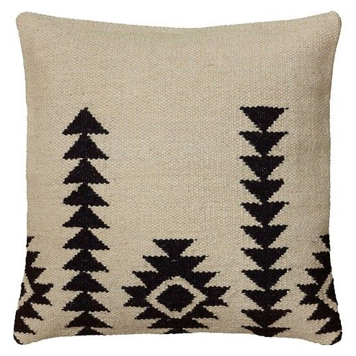 This fun toss pillow will add a touch of pizazz to any plush furnishing you choose to adorn. The Rizzy Home Textured Southwestern Stripe Pillow in Black and Ivory is sure to become a favorite. Made with a cotton and wool blended fabric, this pillow features classic southwestern flair and great style.