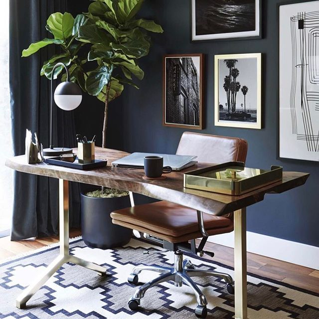 WEBSTA @ potterybarn - Office goals! This navy office from @ginny_macdonald who is the lead designer for @em_henderson makes us want to immediately upgrade our chair game.  Our Nash Leather Swivel chair looks so chic in the space . Now if only Emily could work the same magic on our office cubicle! [: @zekeruelas] #homeoffice #navyblue #interior #design