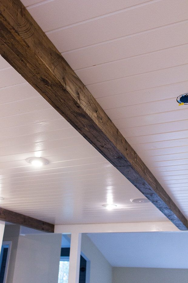 Easy DIY Remodel projects.  Beams, backsplash, barn door, board and batten