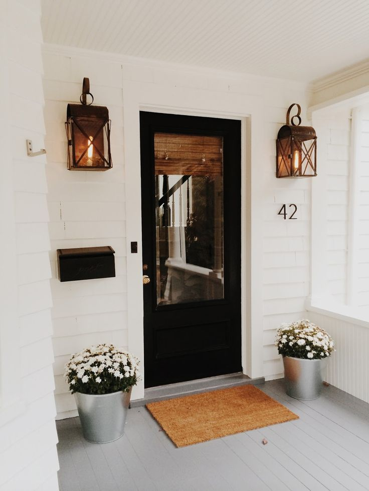 black door, sconce lanterns, back door