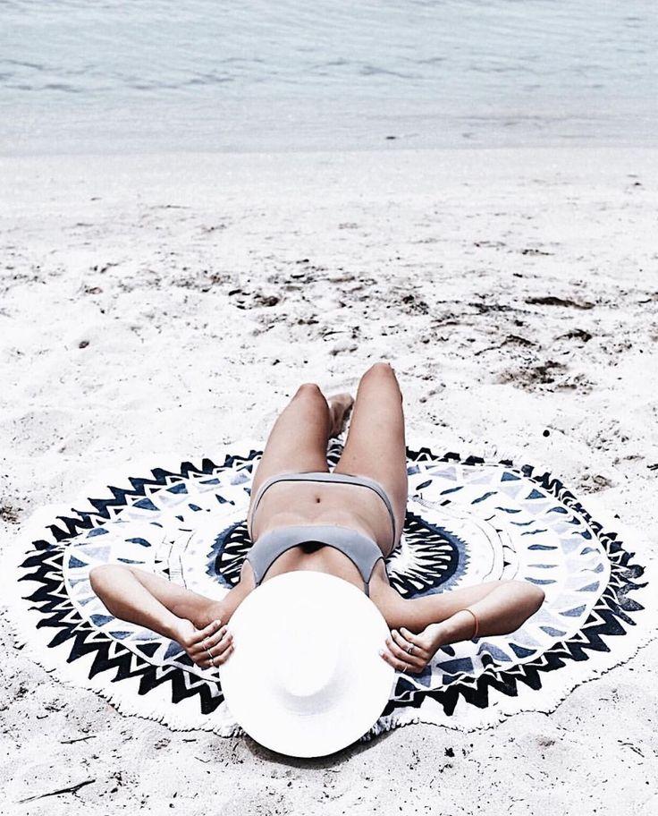 tanned girl relaxing on white beach