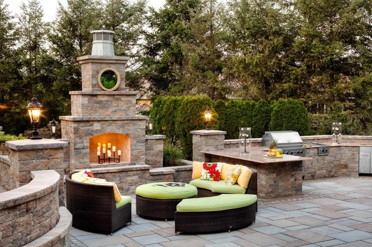"""Stone abounds in this sophisticated traditional outdoor kitchen at the home of Kim Granatell, formerly on """"The Real Housewives of New Jersey."""" She used Source Outdoor furniture when she redid her backyard."""