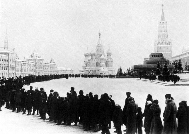 red square, shortly after Lenin's death (I assume), mourners flock to see the Father of Russian Communism lying in state, where he still is today.