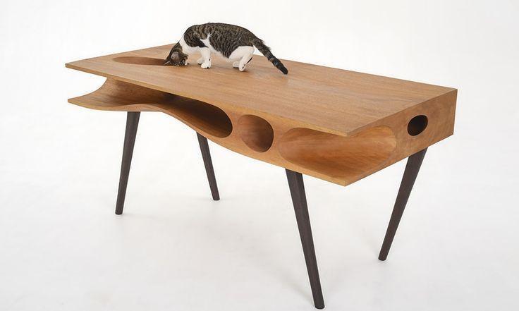 Дизайнер Руан Хаос из Гонконга изобрел стол, который придется по душе любой кошке: CATable имеет туннели и отверстия!