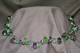 Vine like formation of rising and dipping crystals, with delicate half moon silver spacers