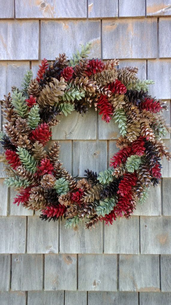 This wreath is wonderful wreath to hang year round. It has red, chocolate brown, tan and sage green. Very pretty. It measures 22 inches from side to