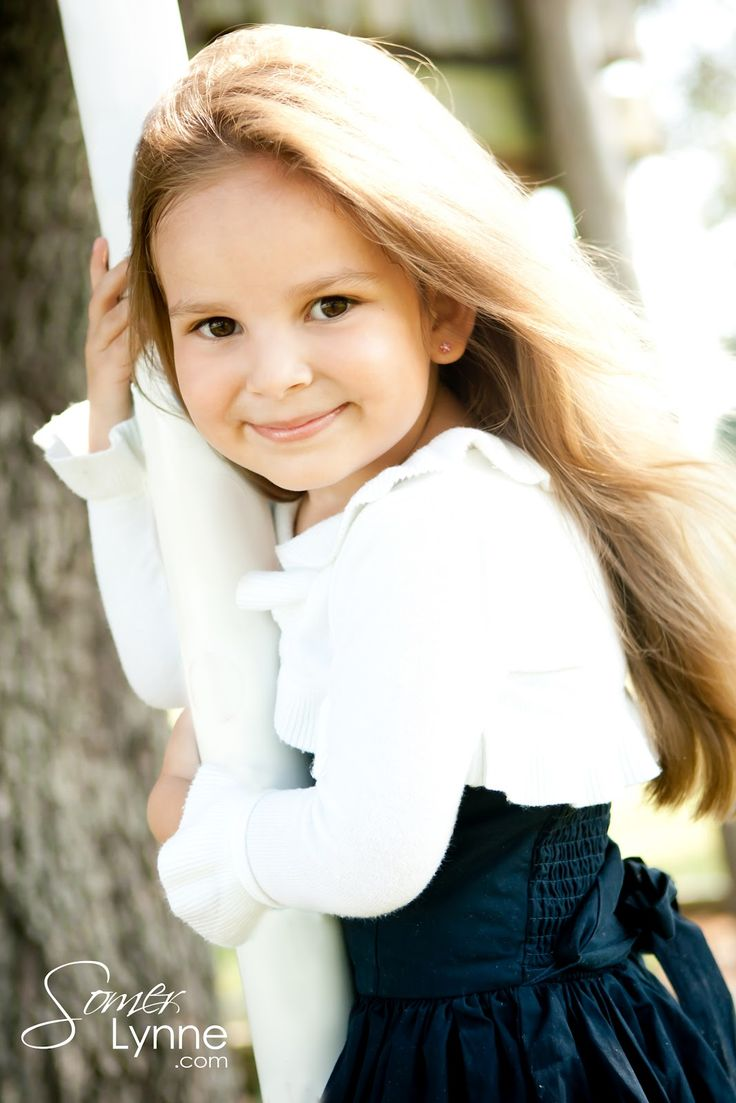 little girl pose. Oh she's darling and she has long beautiful hair. Wow, that's rare these days!