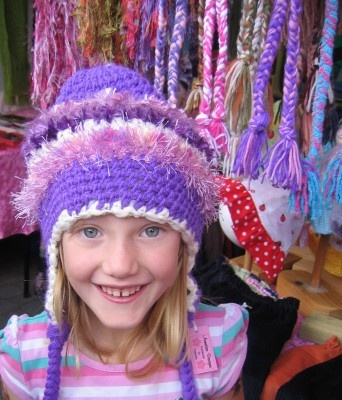 Charli buys a hat during her holiday to Tasmania, at the Salamanca Market (in Hobart every Saturday).