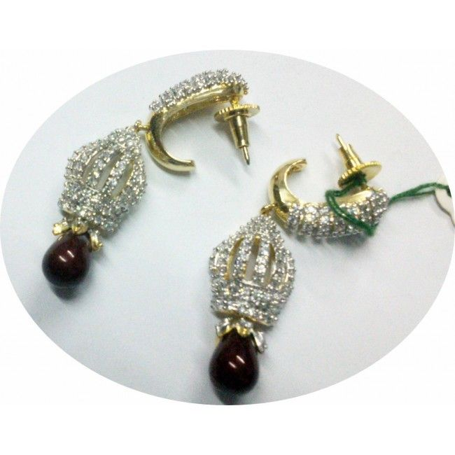 This earring set is made by Indian handicraft workers by various alloy material along with ruby embedding.  http://www.indishcraft.com/default/ruby-pota-earring.html