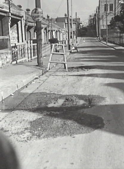 6 August 1956 Angel Street, looking south towards King Street. Showing excavations by the Water Board. The sign for 'Children' s Playground' suggests this ios on the corner of Norfolk Street, with Lilian Fowler Reserve to the right.