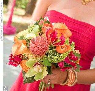 centerpieces - orchids, gloriosa lilies, calla lilies.