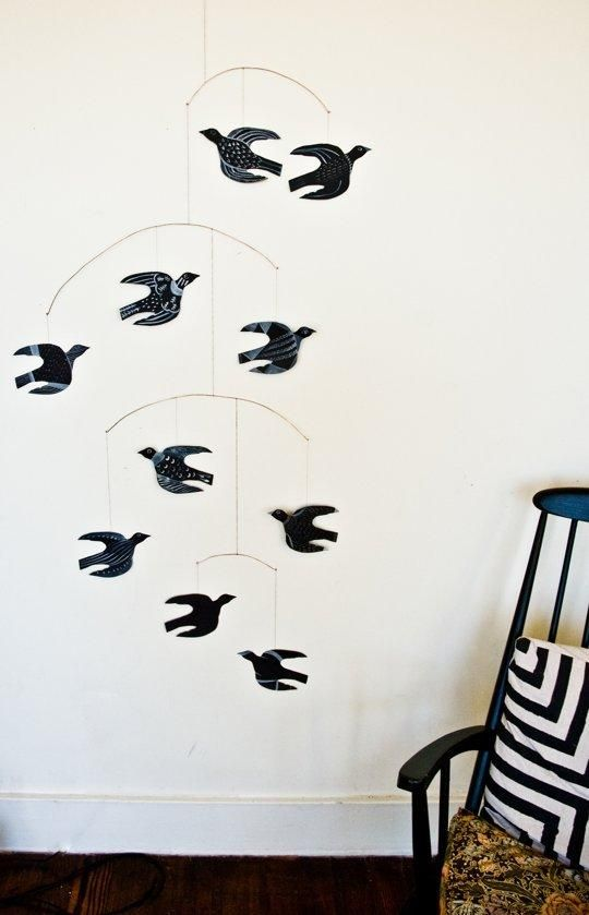 A super-simple (but certainly striking) #DIY bird mobile, made from thick paper, wire, and paint.