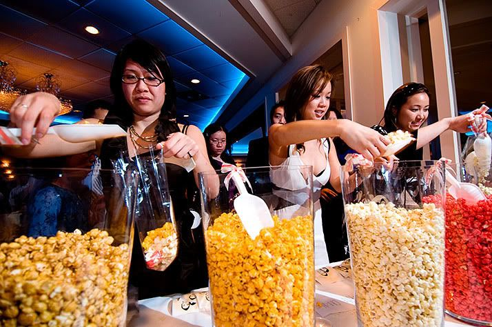Cute idea, have different flavor popcorn for your guest to choose from & they fill the personalized popcorn bag with their favorite flavors.
