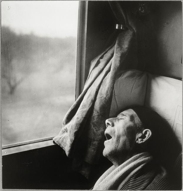 Sleeping Man On A Train by Brassaï