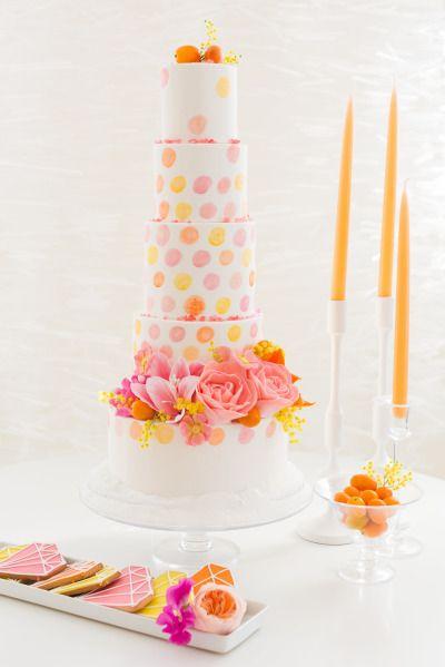 We love this bright polka-dot cake: http://www.stylemepretty.com/new-hampshire-weddings/2015/03/24/moden-citrus-inspiration-shoot/   Photography: Kelsey DeWitt - http://kelseydewitt.com/