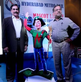 Managing Director, Hyderabad Metro Rail N. V. S. Reddy and Chief Executive and Managing Director, L & T Metro Rail V. B. Gadgil with 'Niz' a mascot for Metro Rail. Photo: Mohammed Yousuf