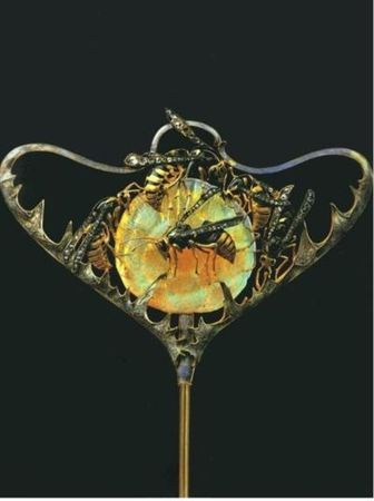 René Lalique hat pin.  Lalique crossed the line with those wasps.  Who wants people swatting their head all day long!?!?!