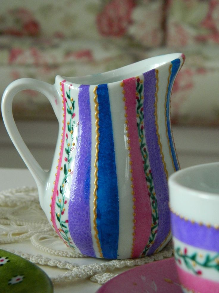 Hand painted - used to serve milk for the morning coffee.